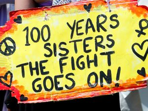 Poster with text: 100 years sisters. The fight goes on!