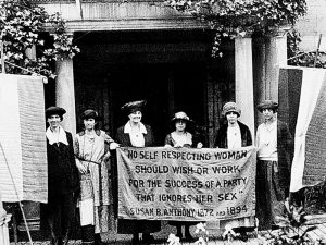 "Women holding banner with quote: ""No self respecting woman should wish or work for the success of a party that ignores her sex."" Susan B. Anthony, 1872 and 1894."