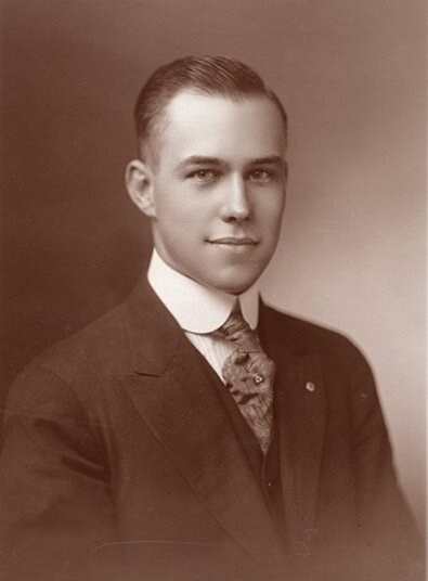 Black and white portrait of a young Harry Burn.